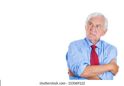 Closeup portrait of an angry, mad, annoyed senior businessman,looking away, isolated on a white background with copy space. Human emotions and interpersonal conflict resolution.