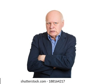 Closeup portrait angry, mad, annoyed, senior mature business man, unhappy looking at you, arms crossed, folded, isolated white background. Human emotion, face expression, attitude, conflict resolution