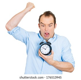 Closeup portrait of angry mad demanding boss business man funny looking guy holding alarm clock, screaming, requesting employees to be on time pushing for project deadline isolated on white background