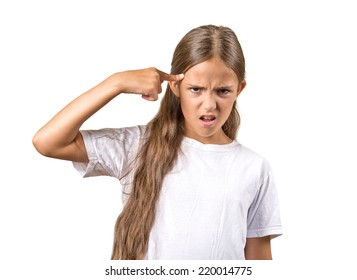 Closeup portrait angry mad teenager girl gesturing with her finger against temple asking are you crazy? Isolated white background. Negative human emotions facial expression feeling body language