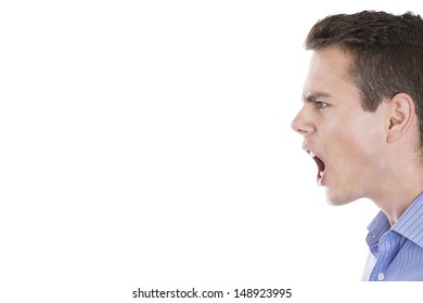 Closeup portrait of angry man screaming isolated on white background with copy space to left