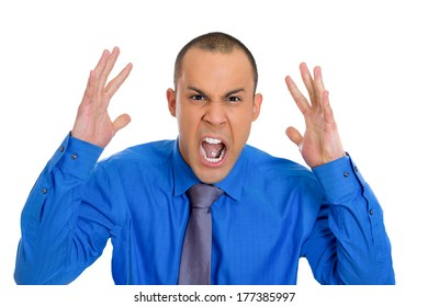 Closeup portrait of angry, screaming man, boss, student, worker, employee, fists in air going through conflict in his life at work isolated white background. Negative face expression, emotion feelings