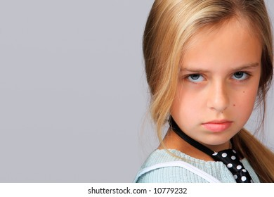 Close-up portrait of an angry teenager with temperament .