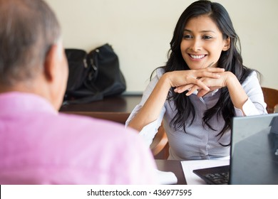 Closeup portrait, appointment with office manager, job interview, hiring, isolated indoors office background. Getting that first job or excellent customer service with a smile