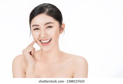 Closeup portrait of asian fair perfect healthy glow skin woman isolated on white background, asian beautiful girl with pretty smile on her face. Beauty clinic skincare spa and surgery concept