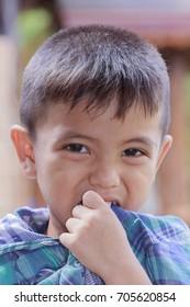 Closeup portrait of Asian handsome little boy sad