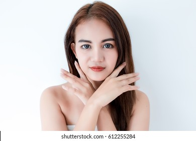 Closeup portrait of asian woman touching face skincare on white background