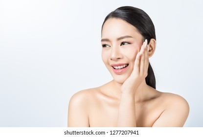 Closeup portrait of attractive asian woman with fair perfect healthy glow skin isolated on white background, asian beautiful girl with pretty smile on face. Beauty clinic skincare spa surgery concept