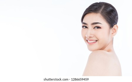 Closeup portrait of attractive asian woman with fair perfect healthy glow skin isolated on white background, asian beautiful girl with pretty smile face. Beauty clinic skincare spa and surgery concept
