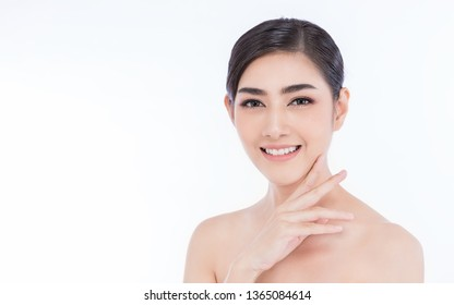 Closeup portrait of attractive asian woman with fair perfect healthy glow skin isolated on white background, asian beautiful girl with mile on her face. Beauty clinic skincare spa and surgery concept