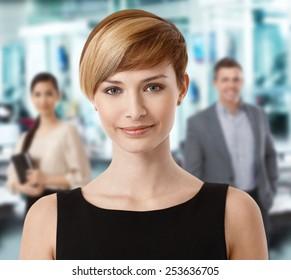 Closeup portrait of attractive businesswoman in office.