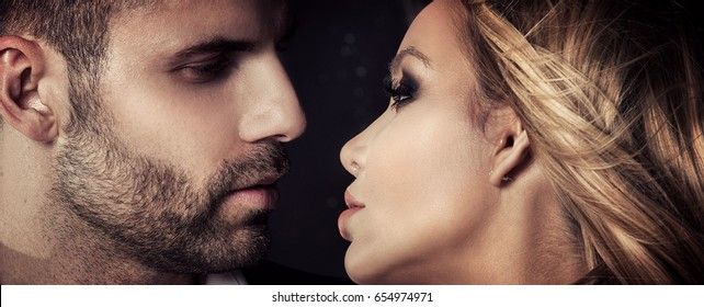 Closeup portrait of attractive caucasian couple looking at each other.