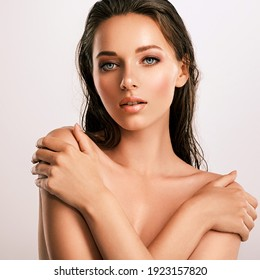 Closeup  portrait of an attractive caucasian girl with wet hair. Model with bright brown eye makeup. Skin care concept.  Young beautiful woman with healthy skin of face.  - Shutterstock ID 1923157820