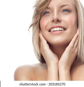 closeup portrait of attractive  caucasian smiling woman blond isolated on white studio shot lips toothy smile face hair head and shoulders looking up blue eyes teeth