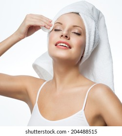 closeup portrait of attractive  caucasian smiling woman blond isolated on white studio shot lips toothy smile face towel applying cream head and shoulders looking at camera blue eyes tooth