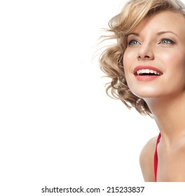 closeup portrait of attractive  caucasian smiling woman blond isolated on white studio shot lips toothy smile face hair head and shoulders looking up blue eyes tooth