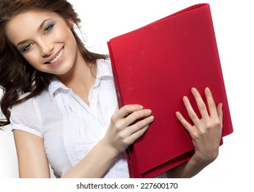 closeup portrait of attractive  caucasian smiling woman brunette isolated on white studio shot toothy smile face hair head and shoulders looking at camera businesswoman papers folders