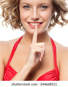 closeup portrait of attractive  caucasian smiling woman blond isolated on white studio shot lips toothy smile face hair head and shoulders looking at camera blue eyes tooth secret
