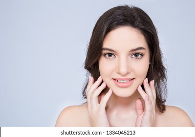 Closeup portrait of attractive caucasian woman fair perfect healthy glow skin makeup isolated on white, young beautiful girl with pretty smile on her face. Beauty clinic skincare spa fashion concept