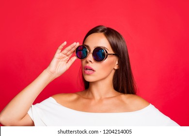 Close-up portrait of attractive charming adorable  lady wearing white off-the-shoulders top blouse touching glasses looking aside isolated over red background