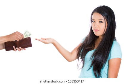 Closeup portrait of attractive female asking for money, guy is handing out dollars to her from brown wallet, isolated on white background