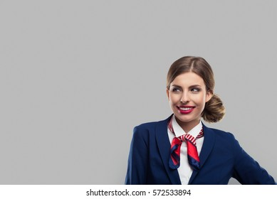 Closeup portrait of attractive flight attendant. Stewardess eyes to the left.