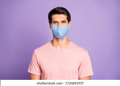 Closeup portrait of attractive glad content brunet guy wear pink t-shirt protection mask on face isolated over violet purple lilac pastel color background - Shutterstock ID 1724691937
