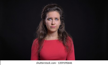 Closeup portrait of attractive middle-aged caucasian female being irritated and making an eye roll in front of the camera