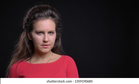 Closeup portrait of attractive middle-aged caucasian female model looking straight and posing in front of the camera