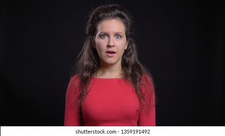 Closeup portrait of attractive middle-aged caucasian female being excited and shocked while looking straight at camera