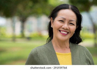 Close-up portrait of attractive senior woman outdoors