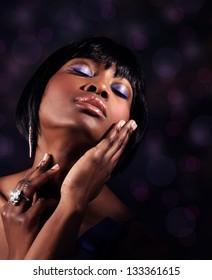 Closeup portrait of attractive sensual black woman with perfect makeup, luxury beauty salon