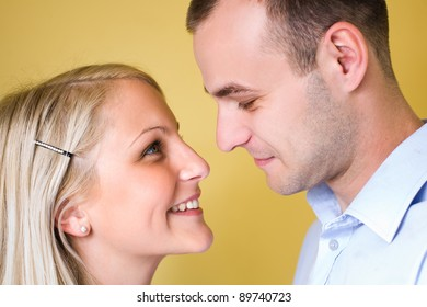 Closeup portrait of an attractive young couple looking at each other.