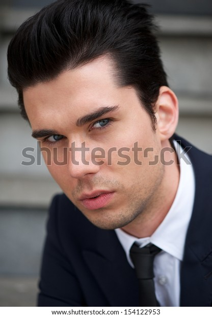 Closeup portrait of an attractive young man posing outdoors