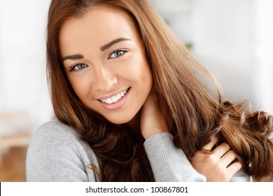 Close-up portrait of an attractive young woman smiling