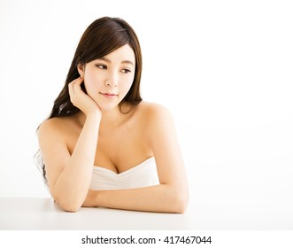Closeup portrait of  attractive young woman thinking
