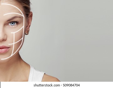 Close-up portrait of attractive young woman face with massage lines. Concept of skin rejuvenation, smooth and correction.