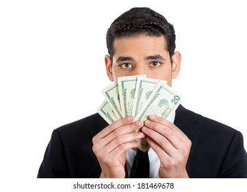 Closeup portrait of banker, executive, ceo, business man, corporate employee hiding behind currency bills, peeking above with eyes, isolated on white background. Financial expressions, emotions