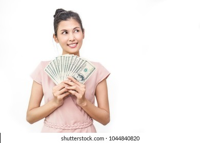 Closeup portrait of beautiful asian woman holding money isolated on white background. Asian girl counting her salary dollar note. Success wealth financial business cashflow currency payment concept.