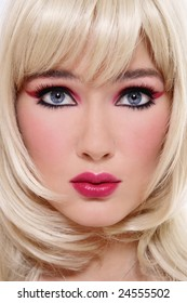 Close-up portrait of beautiful blonde with stylish pink and black makeup