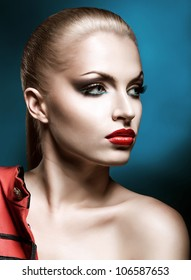 close-up portrait of beautiful blonde woman with red lips