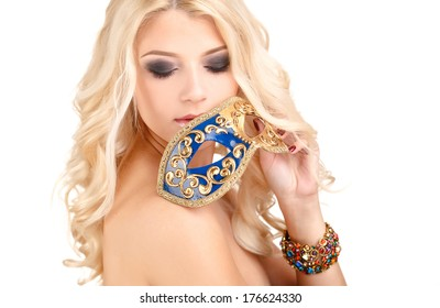 close-up portrait of beautiful blonde woman with facial venetian mask and a hand touching face isolated on white background