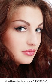 Close-up portrait of beautiful blue-eyed girl with classical glamorous makeup
