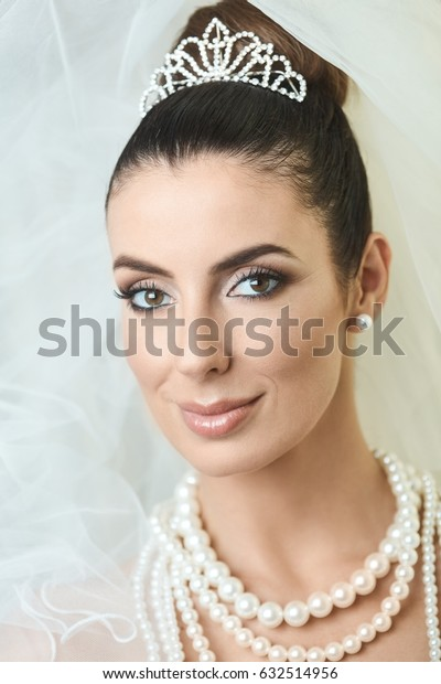 Closeup portrait of beautiful bride with professional makeup.
