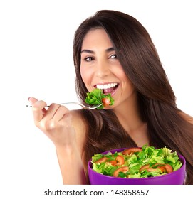 Closeup portrait of beautiful brunette woman eating salad isolated on white background, organic food, healthy lifestyle, dieting concept