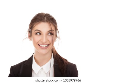 Closeup portrait of a beautiful business woman face looking to the side smiling happy, ecstatic euphoric cheerful girl wearing formal black suit, white shirt cutout isolated on a pure white background