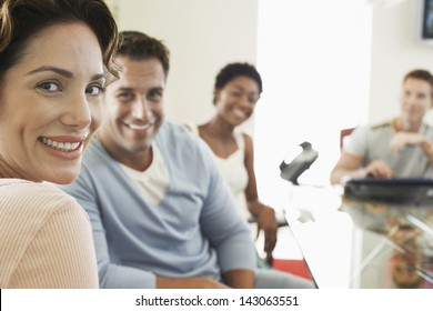 Closeup portrait of beautiful businesswoman with colleagues in conference room
