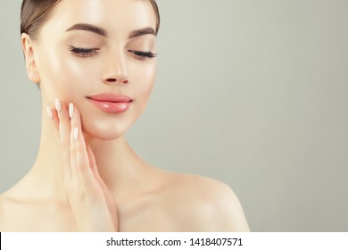 Closeup portrait of beautiful cheerful woman with clear skin