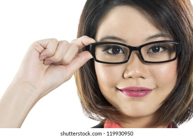 Close-up portrait of a Beautiful Chinese Woman wearing glasses and holding frame.