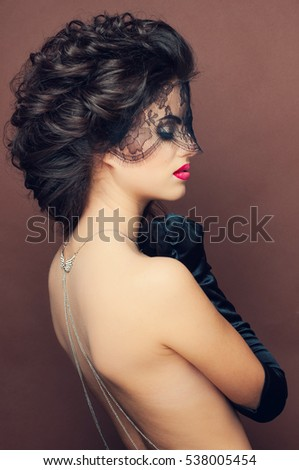 ebded6f3e0dae Closeup portrait of beautiful dark haired girl with glamour makeup and hair  do with black veil